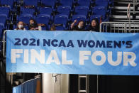 FILE - Fans watch from the stands during the first half of the championship game between Stanford and Arizona in the women's Final Four NCAA college basketball tournament in San Antonio, in this Sunday, April 4, 2021, file photo. A law firm hired to investigate gender equity concerns at NCAA championship events released a blistering report Tuesday, Aug. 3, 2021, that recommended holding the men's and women's Final Fours at the same site and offering financial incentives to schools to improve their women's basketball programs. (AP Photo/Eric Gay, File)