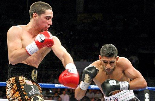 Danny Garcia (L) knocked Amir Khan down three times with the end coming with 32 seconds left in the fourth round