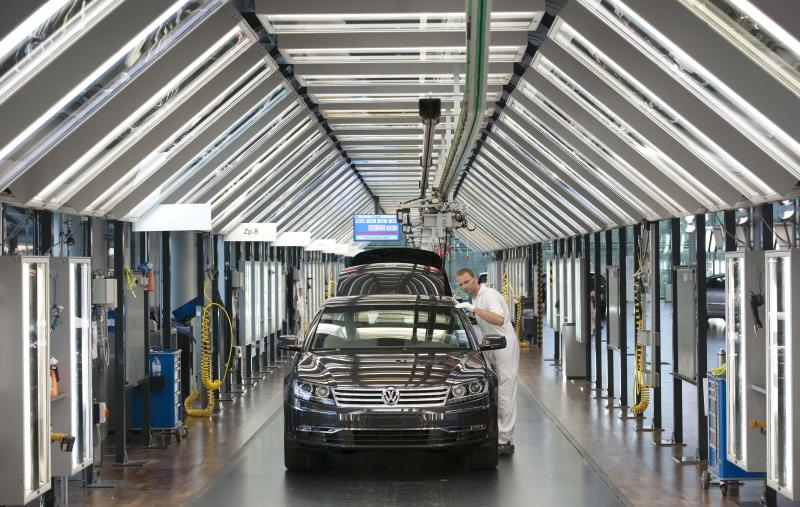 FILE - In this Wednesday, June 1, 2011 file photo, Thomas Mehlhose works at the assembly line for the Volkswagen Phaeton in Dresden, eastern Germany. The European car industry showed further signs of distress Tuesday, July 16, 2013 as new data revealed car sales were down 6.6 percent for the first half of the year compared with the same period in 2012. (AP Photo/Jens Meyer, File)