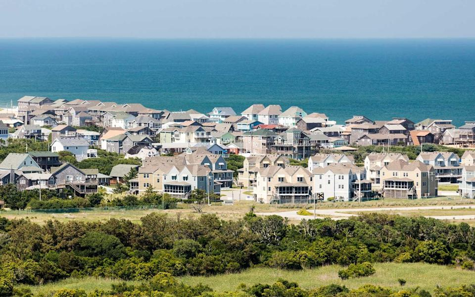 """<p>This string of barrier islands off the North Carolina coast has long drawn authors and artists who are inspired by its tempestuous waters, secluded location, and storied history (the Wright brothers flew the first successful airplane here). The best island for a solo traveler is <a href=""""http://www.travelandleisure.com/articles/lighthouses-lure-travelers-with-historic-mystery"""" rel=""""nofollow noopener"""" target=""""_blank"""" data-ylk=""""slk:Hatteras"""" class=""""link rapid-noclick-resp"""">Hatteras</a>: It has fishing, kayaking, some of the best <a href=""""http://www.travelandleisure.com/slideshows/10-best-us-shelling-beaches"""" rel=""""nofollow noopener"""" target=""""_blank"""" data-ylk=""""slk:shell collecting"""" class=""""link rapid-noclick-resp"""">shell collecting</a> on the coast, and dozens of pretty little beach cottages to rent.</p>"""