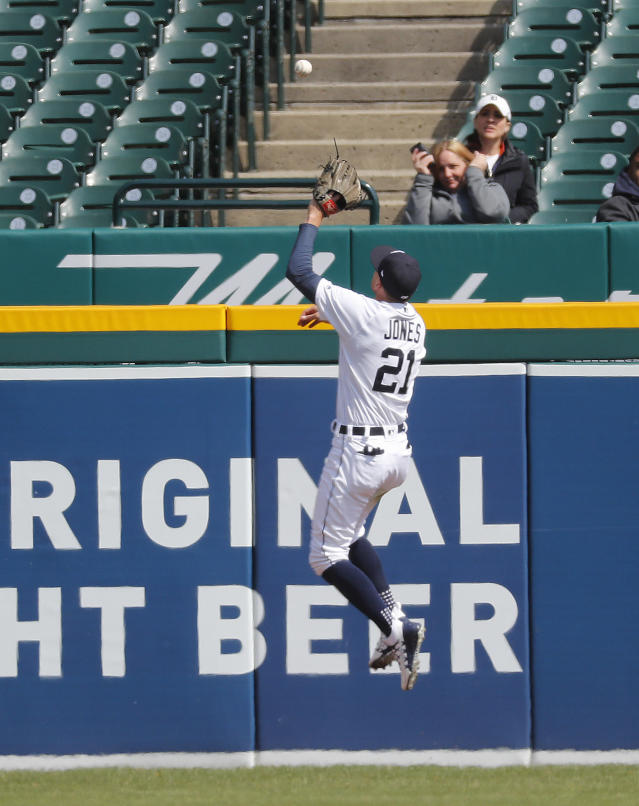 Detroit Tigers left fielder JaCoby Jones (21) jumps to catch a Baltimore Orioles' Chris Davis fly ball off the fence in the eighth inning of a baseball game in Detroit, Wednesday, April 18, 2018. Manny Machado scored on the play. (AP Photo/Paul Sancya)