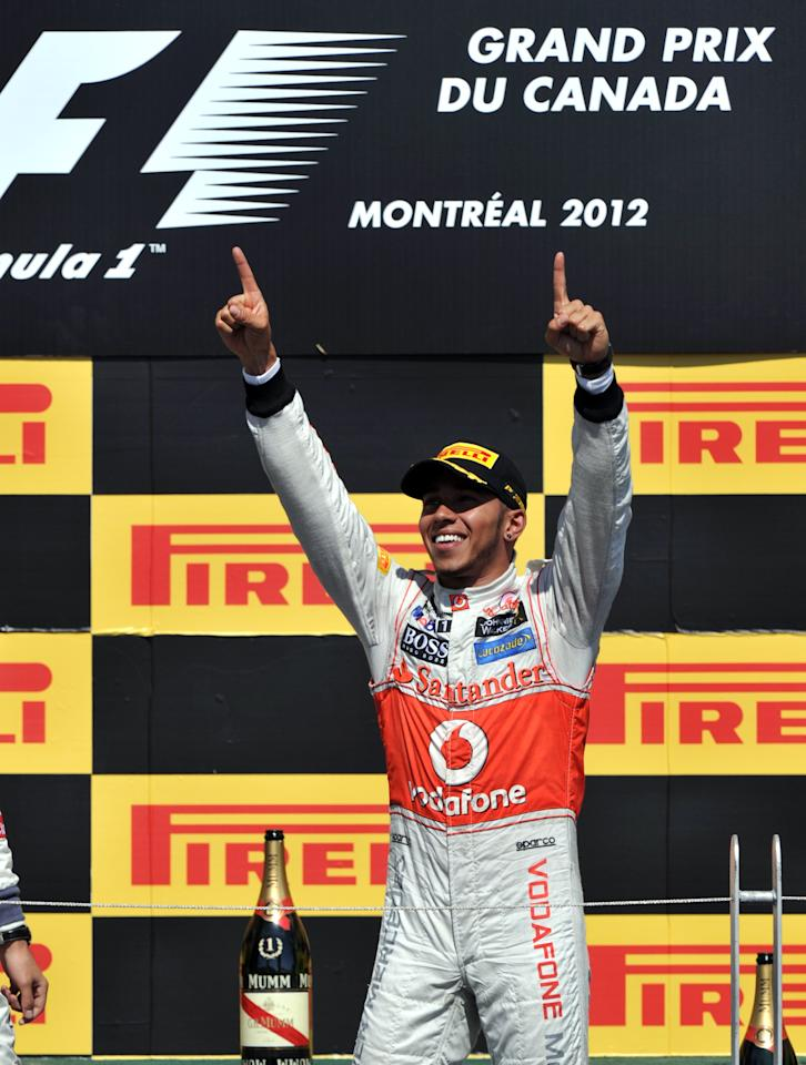 Winner McLaren Mercedes driver Lewis Hamilton of Britain celebrates on the podium after the Canadian Formula One Grand Prix on June 10, 2012 at the Circuit Gilles Villeneuve in Montreal.     AFP PHOTO/Stan HONDASTAN HONDA/AFP/GettyImages