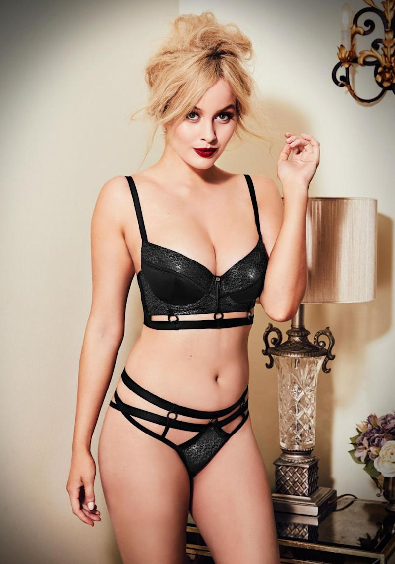 The model further shows off her vampy side in a black glitter skimpy bra and pants set baring some enviable cleavage. Source: Bras N Things
