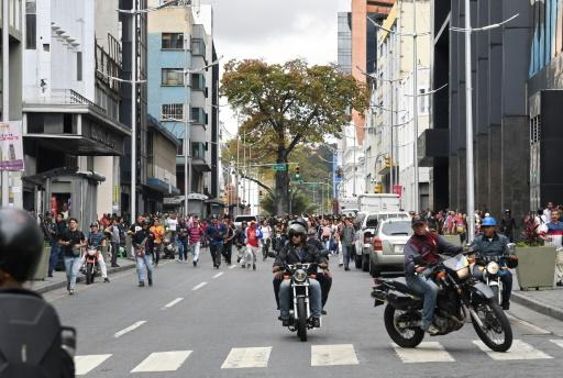 """Armed pro-government civilians known as """"colectivos"""" - like these that allegedly fired on opposition lawmakers - have an infamous reputation in Venezuela"""