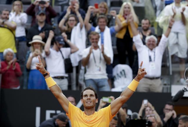 Spain's Rafael Nadal celebrates after beating Germany's Alexander Zverev in their final match at the Italian Open tennis tournament, in Rome, Sunday, May 20, 2018. Nadal won 6-1, 1-6, 6-3. (AP Photo/Gregorio Borgia)