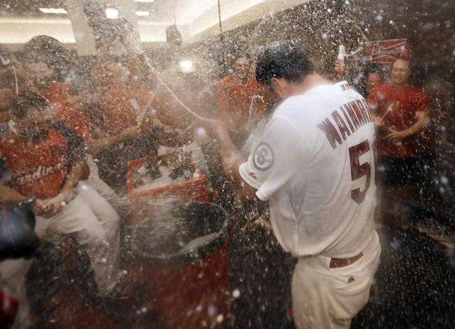 St. Louis Cardinals pitcher Adam Wainwright (50) celebrates in the locker room after the Cardinals defeated the Pittsburgh Pirates 6-1 in Game 5 in a National League baseball division series, Wednesday, Oct. 9, 2013, in St. Louis. The Cardinals advanced to the NL championship series against the Los Angeles Dodgers. (AP Photo/Jeff Roberson)