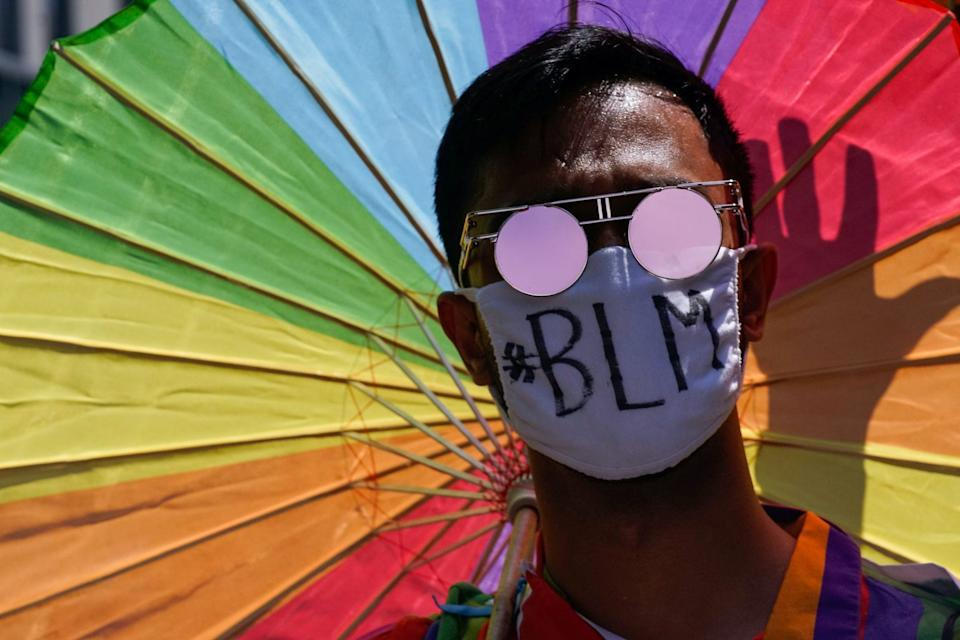 demonstrator wears a face mask during a joint LGBTQ and Black Lives Matter march on the 51st anniversary of the Stonewall riots in New York City, New York, U.S. June 28, 2020.