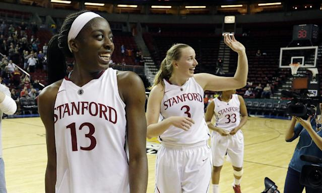 Stanford forward Chiney Ogwumike (13) smiles as she walks off the court with Mikaela Ruef (3) after they defeated Colorado 69-54 in an NCAA college basketball game in the second round of the Pac-12 women's tournament on Friday, March 7, 2014, in Seattle. (AP Photo/Ted S. Warren)