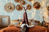 <p>If you own an abundance of hats, they just so happen to double as great art pieces! Stick a bunch of command hooks on your wall and hang them there for future events - it's both practical and decorative.</p>