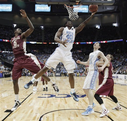 North Carolina forward Harrison Barnes (40) shoots as Florida State forward Bernard James (5) and guard Deividas Dulkys (4) and North Carolina forward Tyler Zeller (44) watch during the first half of an NCAA college basketball game in the final of the Atlantic Coast Conference mens' tournament, Sunday, March 11, 2012, in Atlanta. (AP Photo/Chuck Burton)