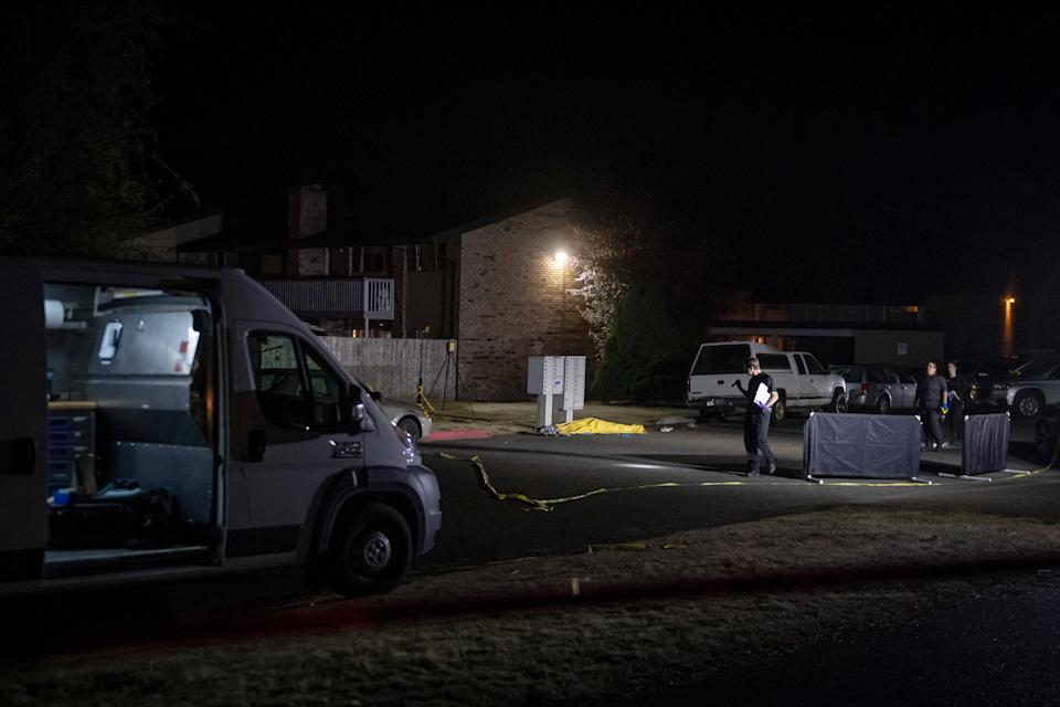 Police investigators near the body of Michael Reinoehl in Lacey, Wash., on Thursday night, Sept. 3, 2020. (Joshua Bessex/The New York Times)