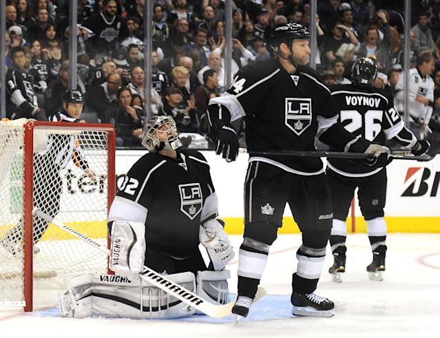 LOS ANGELES, CA - APRIL 22: Jonathan Quick #32 and Robyn Regehr #44 of the Los Angeles Kings react after a goal by Patrick Marleau #12 of the San Jose Sharks for a 4-3 win during overtime in Game Three of the First Round of the 2014 NHL Stanley Cup Playoffs at Staples Center on April 22, 2014 in Los Angeles, California. (Photo by Harry How/Getty Images)
