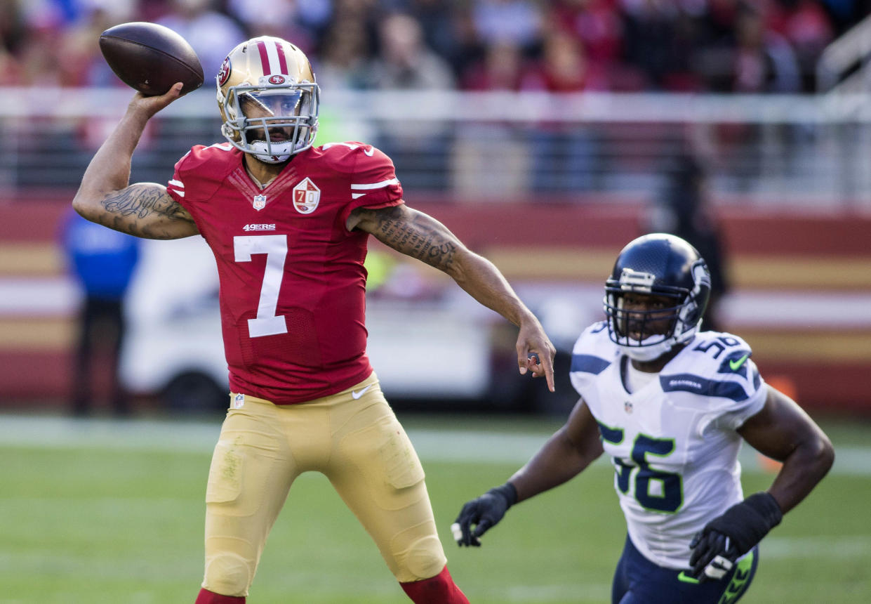 Jan 1, 2017; Santa Clara, CA, USA; San Francisco 49ers quarterback Colin Kaepernick (7) passes the football while being rushed by Seattle Seahawks defensive end Cliff Avril (56) during the first quarter at Levis Stadium. Mandatory Credit: Neville E. Guard-USA TODAY Sports