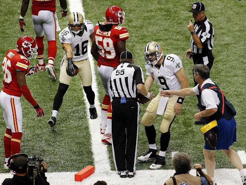 New Orleans Saints quarterback Drew Brees (9) challenges the official after wide receiver Lance Moore (16) hit the pylon in the second half of an NFL football game against the Kansas City Chiefs in New Orleans, Sunday, Sept. 23, 2012. After review the pass was ruled incomplete. (AP Photo/Jonathan Bachman)