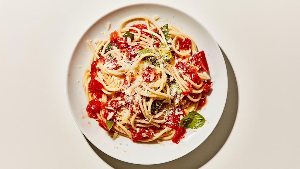 """The seeds and surrounding juice/jelly inside tomatoes can be slightly bitter and astringent, which is why we squeeze them out before chopping the flesh. This step also prevents the sauce from getting too watery, so it clings to the pasta better. Plus, some people just really don't like the texture of the seeds! <a href=""""https://www.bonappetit.com/recipe/pasta-with-no-cook-tomato-sauce?mbid=synd_yahoo_rss"""" rel=""""nofollow noopener"""" target=""""_blank"""" data-ylk=""""slk:See recipe."""" class=""""link rapid-noclick-resp"""">See recipe.</a>"""