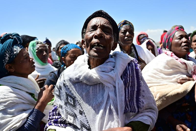 Oromo women perform a traditional chant at the crash site at Hama Quntushele village, in Oromia region (AFP Photo/TONY KARUMBA)