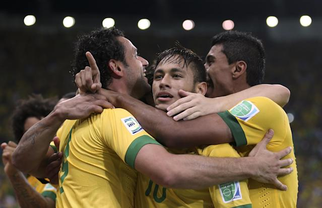 FILE - In this June 30, 2013 file photo, Brazil's Fred, left, celebrates with teammates Neymar, center and Paulinho after scoring his side's 3rd goal against Spain during the soccer Confederations Cup final match at the Maracana stadium in Rio de Janeiro, Brazil. Brazilian fans hoping for a home-team win at thisyear's World Cup are hoping just as hard that archrival Argentina does not lift the trophy.(AP Photo/Andre Penner, File)