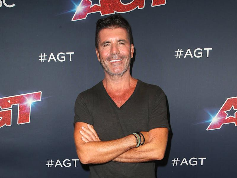 Simon Cowell writing a children's book with son