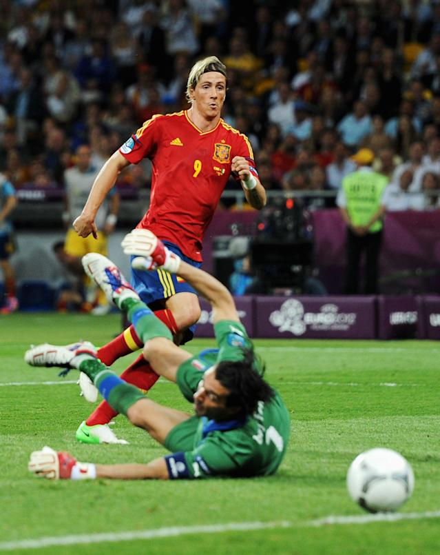 KIEV, UKRAINE - JULY 01: Fernando Torres of Spain scores his team's third goal past Gianluigi Buffon of Italy during the UEFA EURO 2012 final match between Spain and Italy at the Olympic Stadium on July 1, 2012 in Kiev, Ukraine. (Photo by Jasper Juinen/Getty Images)