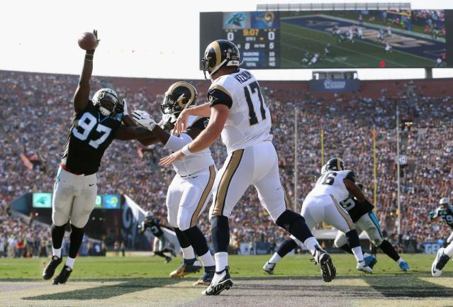 <p>Mario Addison #97 of the Carolina Panthers blocks a pass by quarterback Case Keenum #17 of the Los Angeles Rams in the endzone during the first quarter of the game at the Los Angeles Coliseum on November 6, 2016 in Los Angeles, California. (Photo by Stephen Dunn/Getty Images) </p>