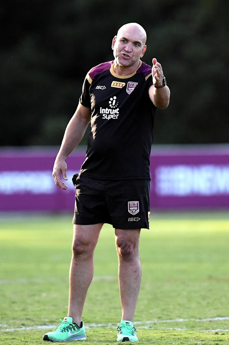 Gordon Tallis pointing out some moves in training.