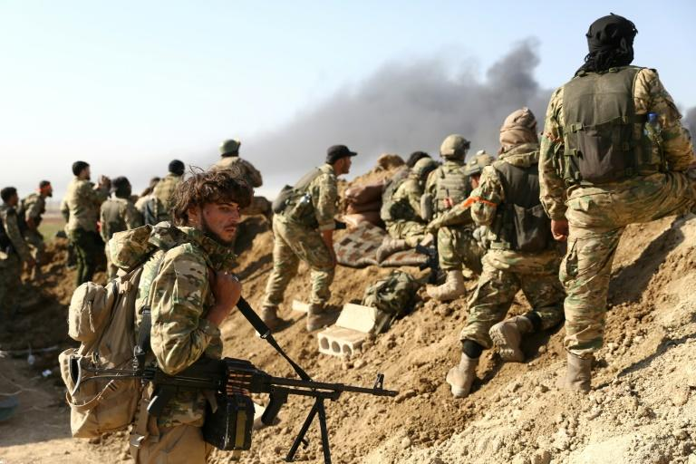 Turkish troops and their Syrian allies step up their offensive against Kurdish forces, thrusting into the key border town of Ras al-Ain