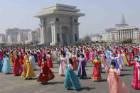 Women dance near the Arch of Triumph on the Day of the Sun, the birth anniversary of late leader Kim Il Sung, in Pyongyang, North Korea Thursday, April 15, 2021. (AP Photo/Jon Chol Jin)