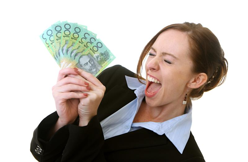 Woman holding Australian money