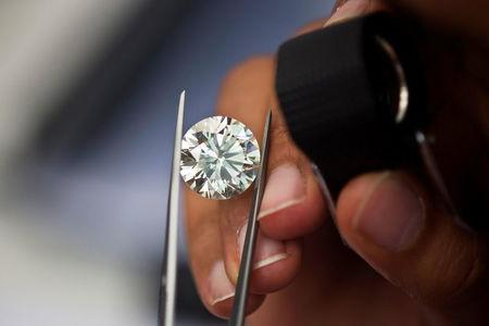 FILE PHOTO: A trader inspects a diamond during a four-day show at Israel's Diamond Exchange near Tel Aviv