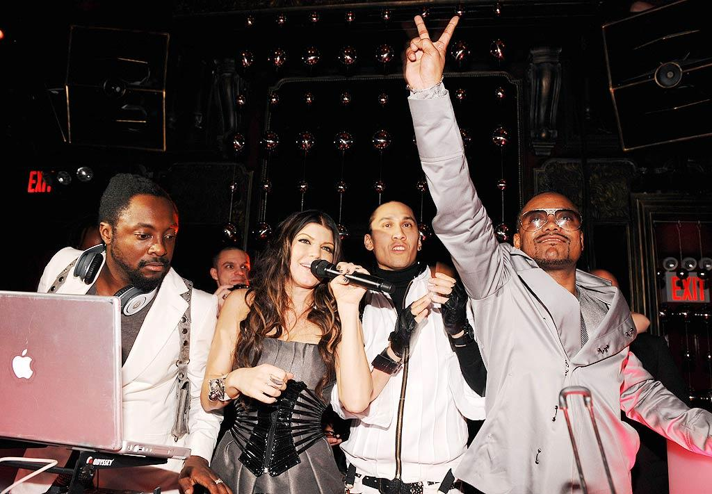 "Boom boom pow! Joined by famous friends like Rihanna and Wilmer Valderrama, the Black Eyed Peas celebrated the release of their new album, ""The E.N.D.,"" on Wednesday. Dimitrios Kambouris/<a href=""http://www.gettyimages.com/"" target=""new"">GettyImages.com</a> - June 10, 2009"