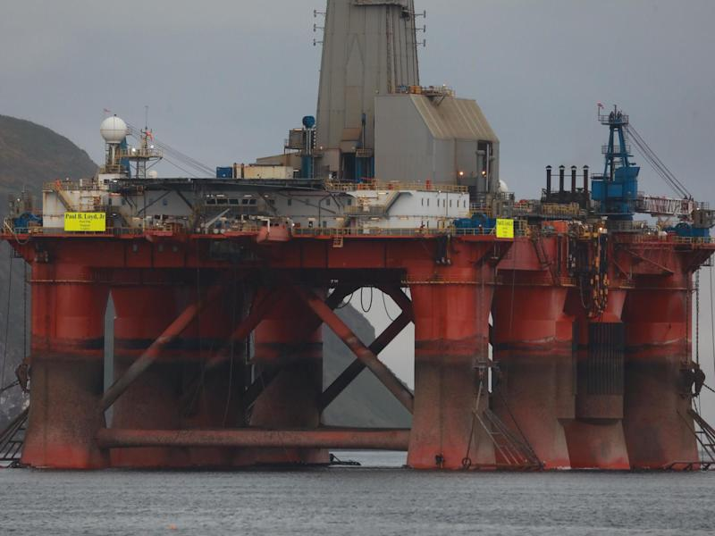 Greenpeace climbers on the oil rig in Cromarty Firth, Scotland as it was being towed out to sea: Greenpeace/PA Wire