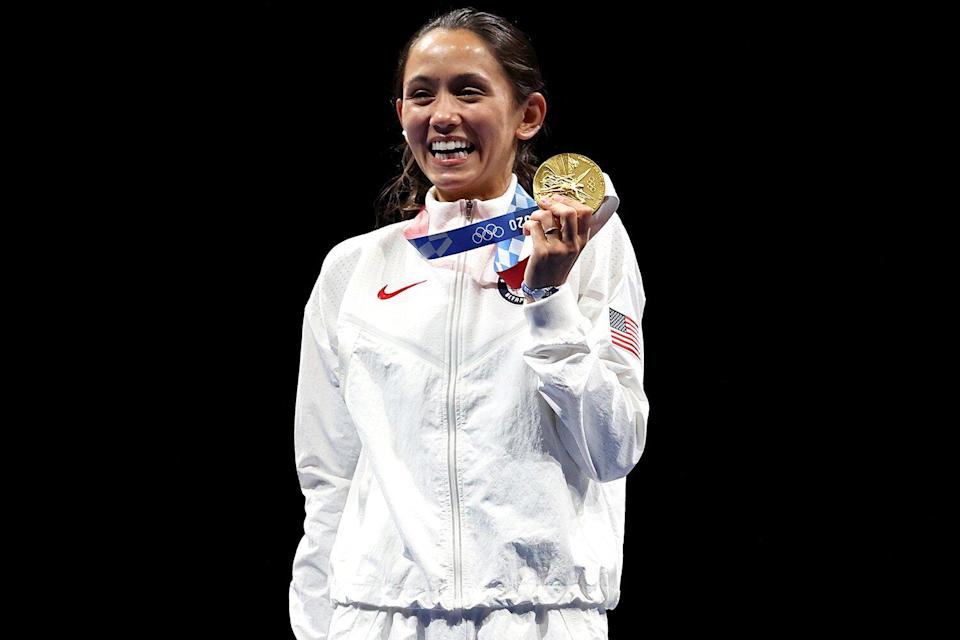 Gold medalist Lee Kiefer of Team United States poses on the podium during the medal ceremony for the Women's Foil Individual Fencing Gold Medal event on day two of the Tokyo 2020 Olympic Games at Makuhari Messe Hall on July 25, 2021 in Chiba, Japan.