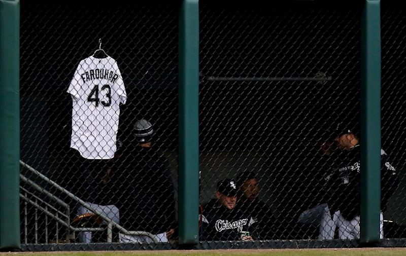 The jersey of Danny Farquhar of the Chicago White Sox, who is fighting for his life after emergency surgery to reduce swelling from a brain hemorrhage, hangs on the bullpen fence
