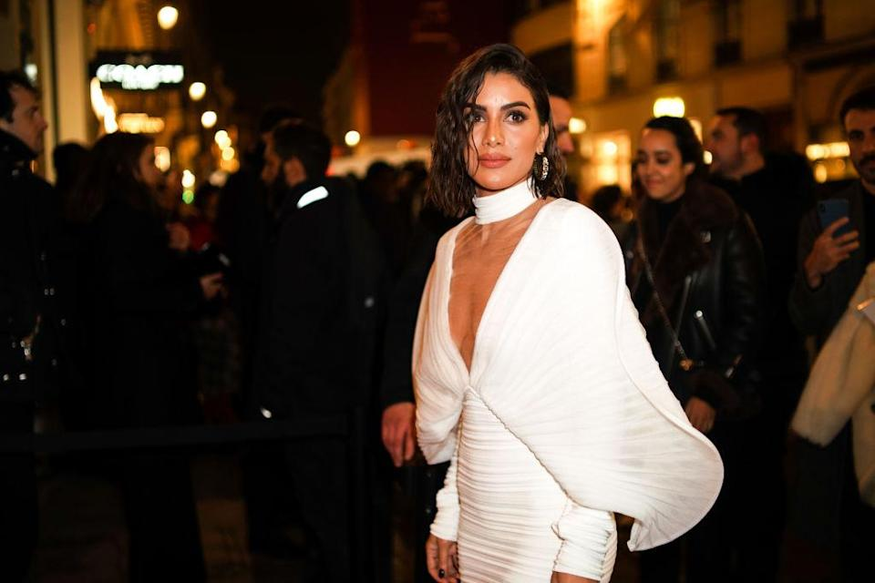 Camila Coelho wears a white dress, outside Balmain, during Paris Fashion Week – Haute Couture Spring Summer 2020, on January 23, 2019 in Paris, France. (Photo by Edward Berthelot/Getty Images)
