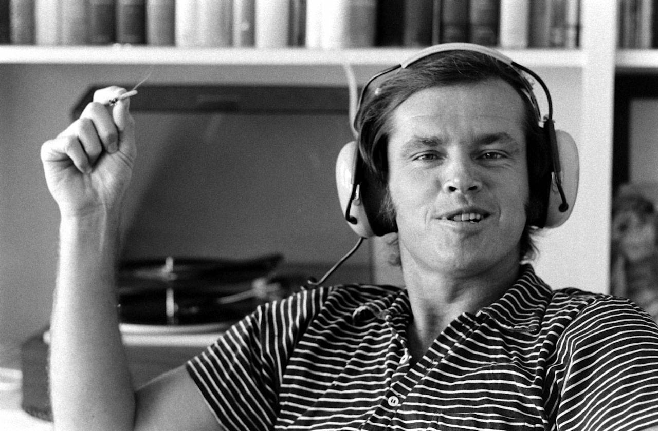 """Not published in LIFE. Jack Nicholson at home in Los Angeles, 1969. In an issue of LIFE from March 1970, the magazine noted that Nicholson """"is a rock fan who enjoys his music with a headset."""""""
