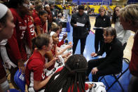 Stanford head coach Tara VanDerveer, seated, goes over a play during a timeout during the third quarter of an NCAA college basketball game against Mississippi State, in Victoria, British Columbia, Saturday, Nov. 30, 2019. (Chad Hipolito/The Canadian Press via AP)