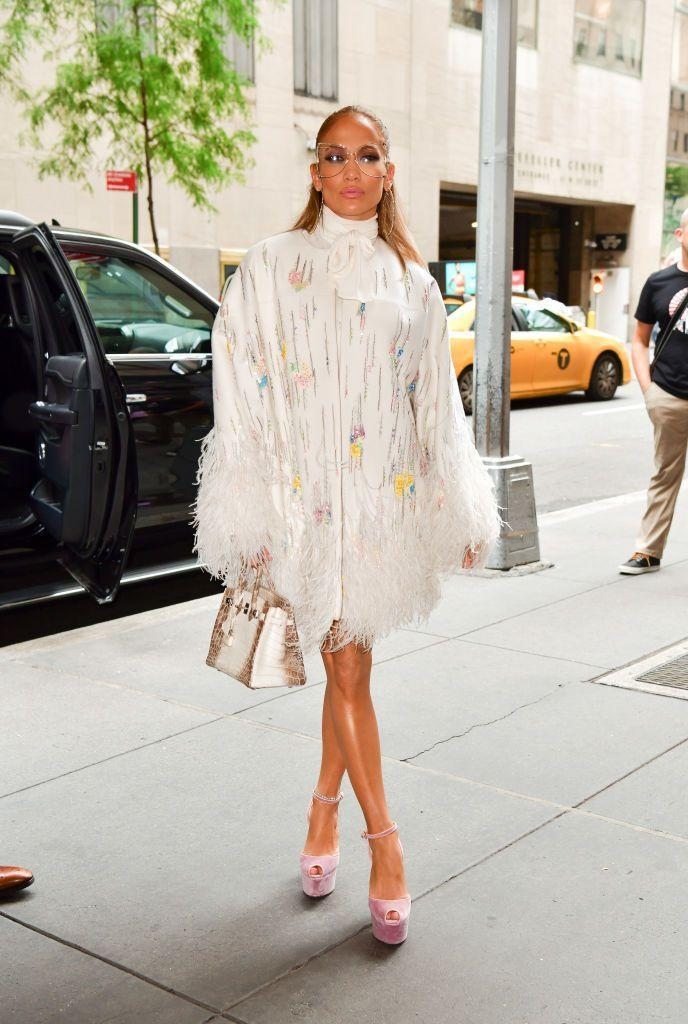 <p>Jennifer poses in a white feathered coat, sky-high platform heels, and statement sunglasses in Manhattan. </p>