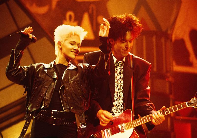 L-R: Marie Fredriksson and Per Gessle of Roxette perform on stage at the Smash Hits Poll Winners Party, Docklands Arena, London, 11th November 1990. (Photo by Phil Dent/Redferns)