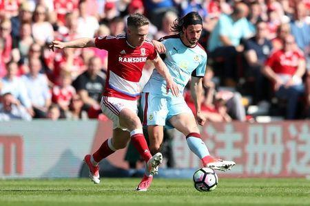 Britain Football Soccer - Middlesbrough v Burnley - Premier League - The Riverside Stadium - 8/4/17 Middlesbrough's Adam Forshaw in action with Burnley's George Boyd Reuters / Scott Heppell Livepic