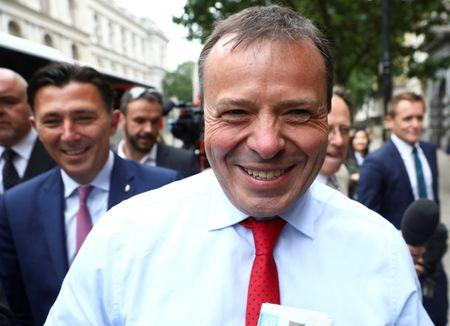 FILE PHOTO: Arron Banks and Andy Wigmore, who ran the Leave.Eu pro-Brexit referendum campaign, arrive to give evidence to the Digital Culture Media and Sport Parliamentary Committee in London, Britain, June 12, 2018. REUTERS/Simon Dawson