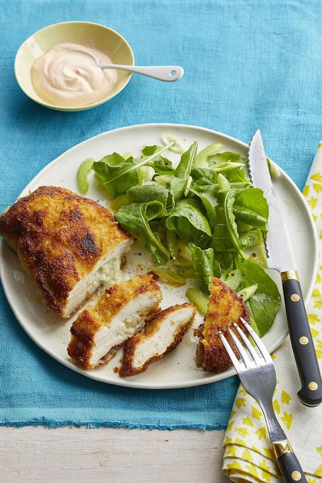"""<p>Add a spicy kick to your dinner with this chicken dish that's breaded with panko bread crumbs and marinated with a special hot sauce. </p><p><strong><a rel=""""nofollow"""" href=""""https://www.womansday.com/food-recipes/food-drinks/recipes/a59762/buffalo-style-chicken-kiev-recipe/"""">Get the recipe.</a></strong></p>"""