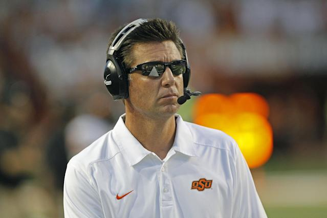 Oklahoma State coach Mike Gundy watches his team during the fourth quarter against Texas in an NCAA college football game Saturday, Nov. 16, 2013, in Austin, Texas. Oklahoma State won 38-13. (AP Photo/Michael Thomas)