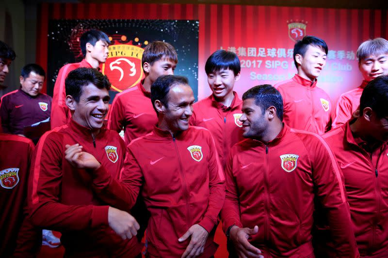 FILE PHOTO: Brazilian soccer players Oscar and Hulk and Portuguese soccer player Ricardo Carvalho attend the 2017 SIPG Football Club's season mobilization of the Chinese Super League, in Shanghai