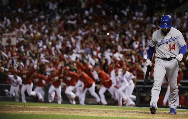 Los Angeles Dodgers' Mark Ellis walks away after striking out to end Game 6 of the National League baseball championship series against the St. Louis Cardinals, Friday, Oct. 18, 2013, in St. Louis. The Cardinals won 9-0 to win the series. (AP Photo/David J. Phillip)