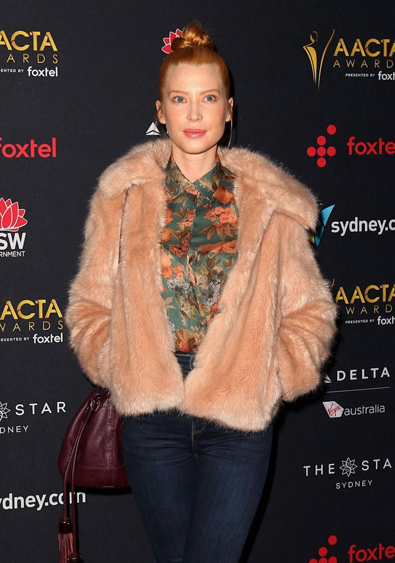 The 35-year-old star teamed her fitted denim trousers with a bright printed blouse, and a statement faux-fur jacket was layered over it. Source: Getty