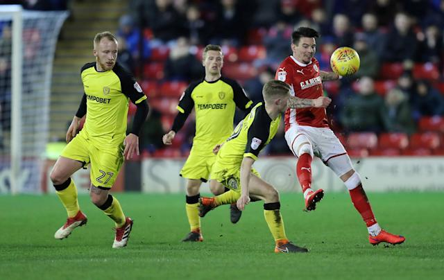 "Soccer Football - Championship - Barnsley vs Burton Albion - Oakwell, Barnsley, Britain - February 20, 2018 Barnsley's Adam Hammill in action with Burton Albion's Jacob Davenport Action Images/John Clifton EDITORIAL USE ONLY. No use with unauthorized audio, video, data, fixture lists, club/league logos or ""live"" services. Online in-match use limited to 75 images, no video emulation. No use in betting, games or single club/league/player publications. Please contact your account representative for further details."