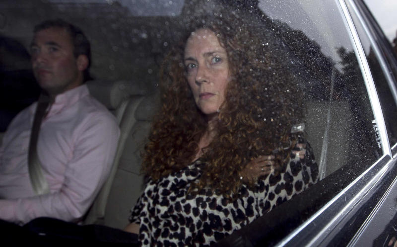 Rebekah Brooks, chief executive of News International is driven away from offices of News International in London, Thursday, July 7, 2011.  News International announced Thursday it is shutting down the News of the World, the best-selling Sunday tabloid at the center of Britain's phone hacking scandal.  James Murdoch, who heads European operations for the paper's parent company, said the 168-year-old weekly newspaper would publish its last edition Sunday. The scandal has cost the Sunday-only paper prestige and prompted dozens of companies to pull their ads.  (AP Photo/Matt Dunham)