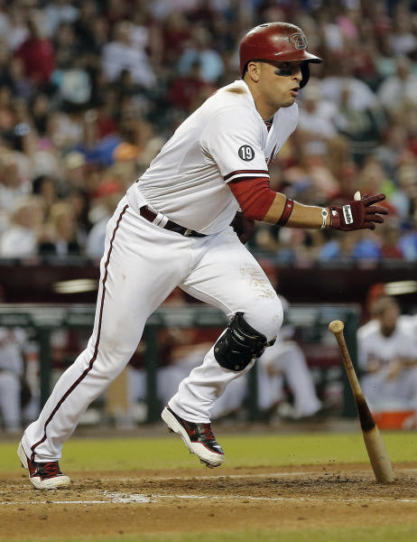 Arizona Diamondbacks' Martin Prado starts to run on his two-RBI triple against the Los Angeles Dodgers during the third inning of a baseball game on2 Thursday, Sept. 19, 2013, in Phoenix. (AP Photo/Matt York)