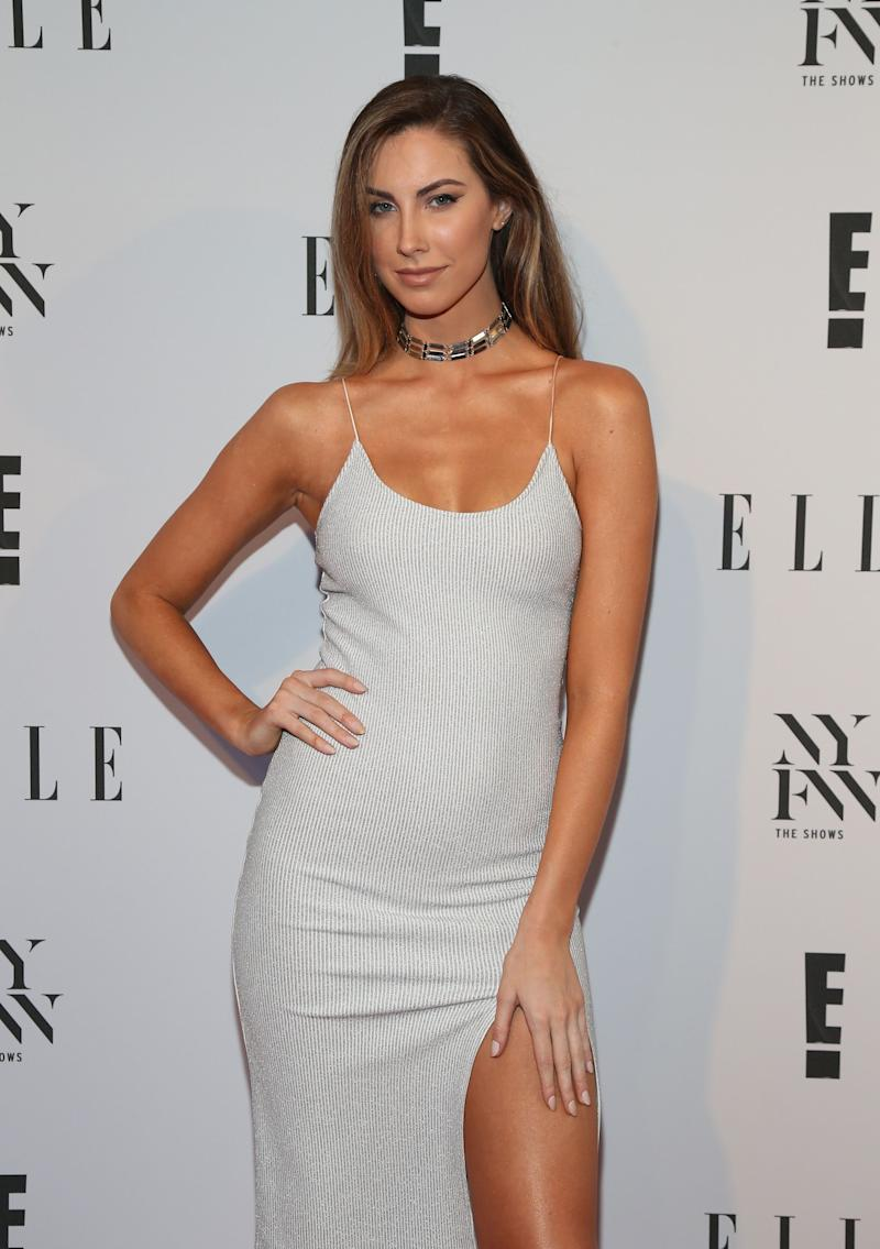 Katherine Webb looks amazing in this white slit dress, as she shows off her tanned leg.