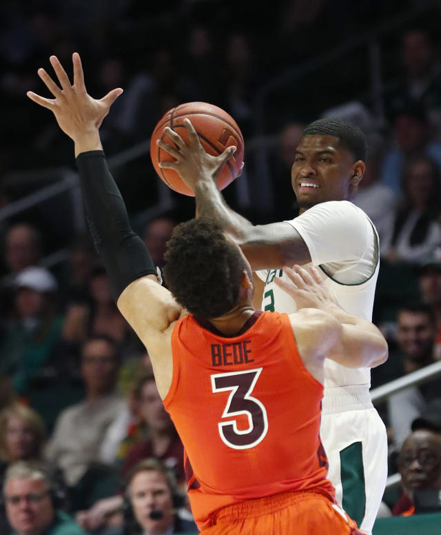 Miami guard Anthony Lawrence II, rear, looks for an open teammate past Virginia Tech guard Wabissa Bede during the first half of an NCAA college basketball game Wednesday, Jan. 30, 2019, in Coral Gables, Fla. (AP Photo/Wilfredo Lee)